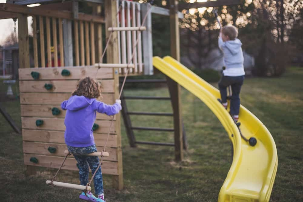 DIY Outdoor Wood Playset With Covered Slide Design